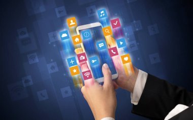 Hand using smartphone with angular app icons