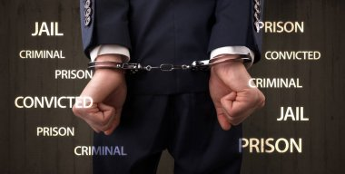 Close convicted with labels and handcuffs