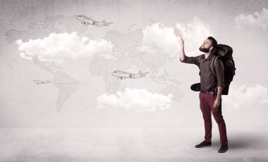 Handsome young man standing with a backpack on his back and planes in front of a world map as a background stock vector