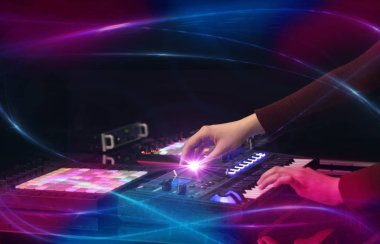 Hand mixing music on dj controller with wave vibe concept