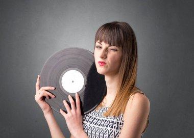 Lady holding vinyl record