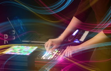 mixing music on midi controller with colorful vibe concept