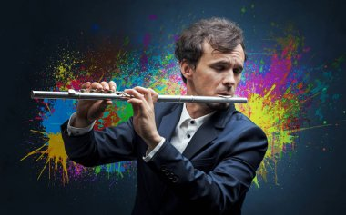 Composer with splotch and his flute