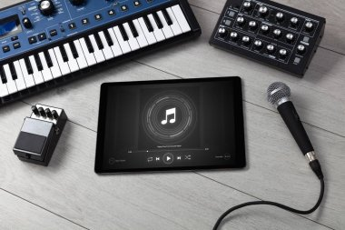 DJ set, tablet and electronic music instruments