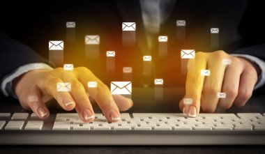 Woman typing on keyboard with chat icons around
