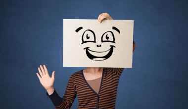 Casual person holding a paper in front of his face with drawn emoticon face stock vector
