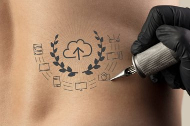 Tattooing communication, leadership and creativity concept on naked back
