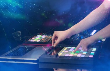 mixing music on midi controller with party club colors around