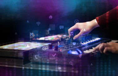 Hand mixing music on midi controller with social media concept