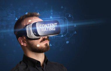Businessman looking through Virtual Reality glasses, social media concept