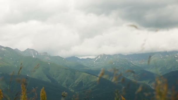 snow-capped mountain peaks with clouds in summer