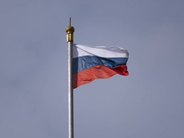 Russian flag fluttering in the wind on a flagpole