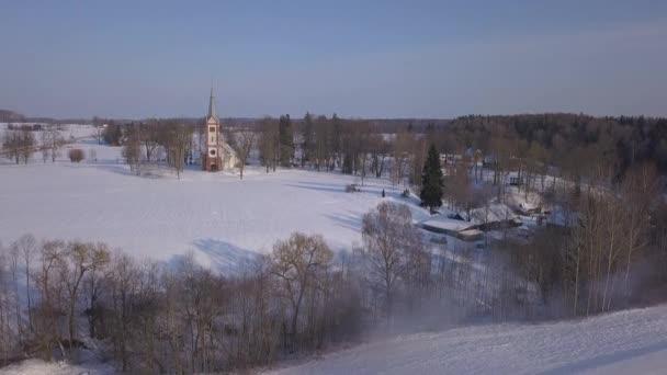 Church Winter field Krimulda Latvia aerial drone top view 4K UHD video