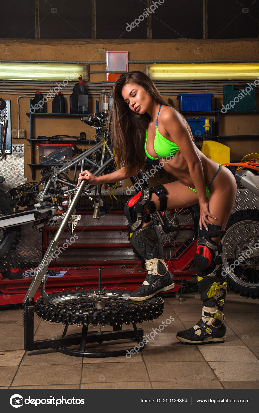 Girl garage motorcycle working studded tires u2014 stock photo