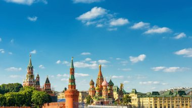 Aerial panoramic view of Moscow centre, Russia. The Red Square with Moscow Kremlin and St Basil's Cathedral in summer. Beautiful panorama of sunny Moscow on the blue sky background with copy space.