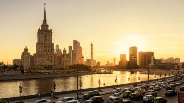 Moscow - August 27, 2018: Beautiful panoramic view of Moscow with hotel Ukraine at sunset, Russia. Sunny panorama of Moskva River in summer evening. Cityscape of Moscow with embankment in sun light.