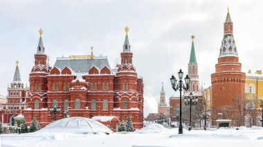Manezhnaya Square near Moscow Kremlin in winter, Russia. It is one of the main tourist attractions in Moscow. Panoramic view of central Moscow during snowfall. Winter cityscape of historical Moscow.