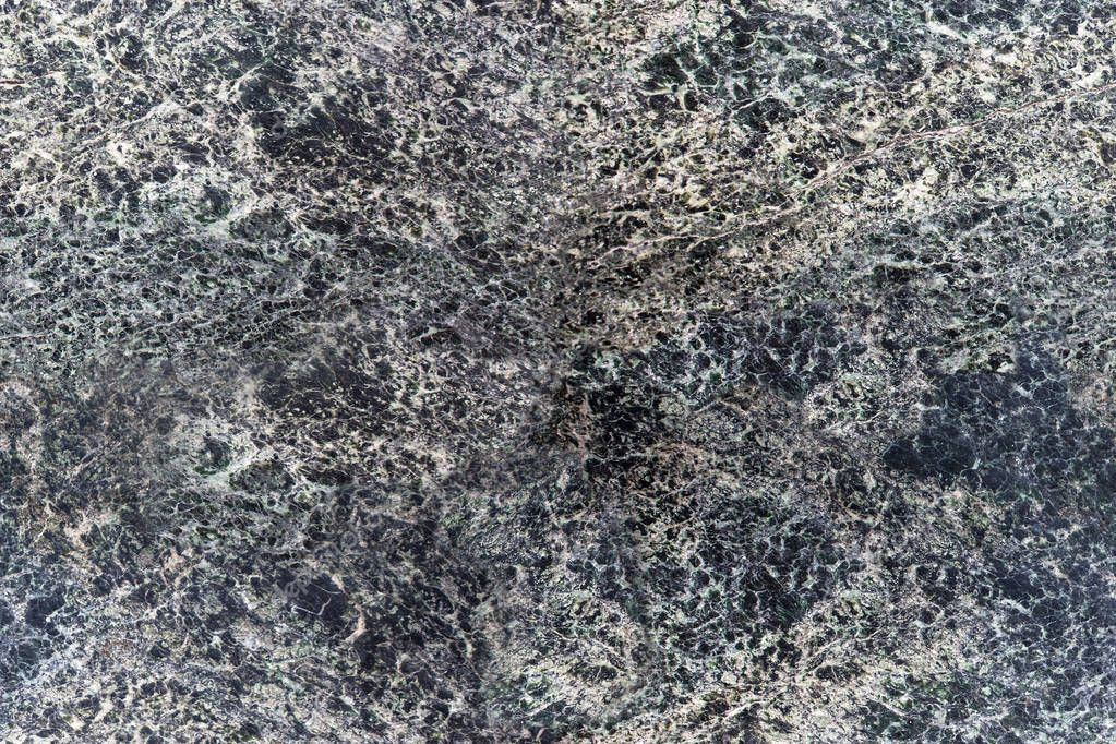 Seamless closeup of polished granite texture. Can be used for background or wallpaper