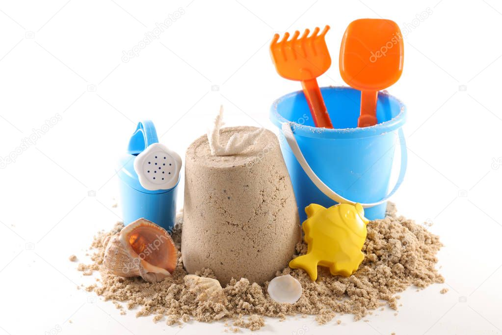 holiday concept, sand and baby toys