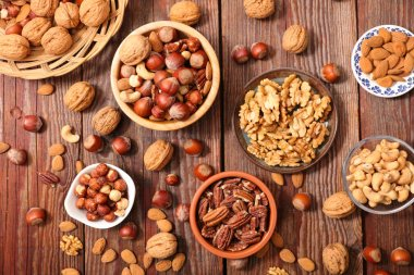 mixed dried nuts on wooden table