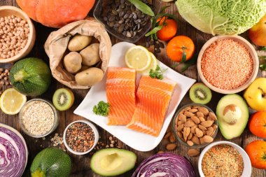 various assorted healthy food on wooden table, diet food concept