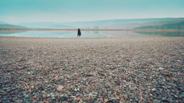 Woman walking near the lake