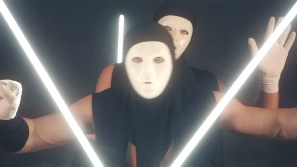 Men in white masks