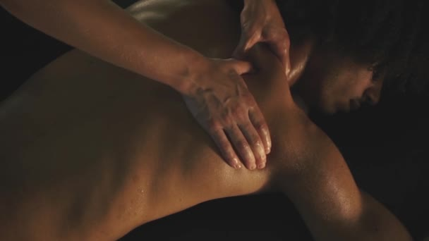 Man relaxing with massage at spa