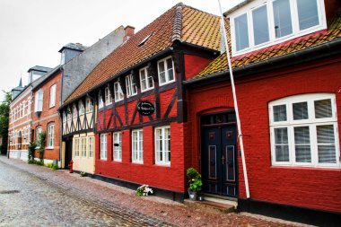 RIBE, DENMARK - JULY 4, 2011: Empty morning street with old houses from royal town Ribe in Denmark.