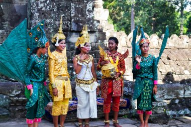 SIEM REAP, CAMBODIA - SEPTEMBER 18: Apsara dancers performs for tourists at Angkor Wat temple in Siem Reap, Cambodia on September 18, 2011. Apsara Dance is a Khmer classical dance.