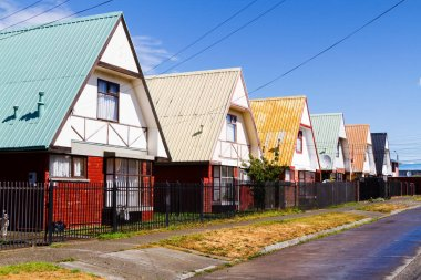 Row of vivid colourful timber, wooden houses, Punta Arenas, Patagonia, Chile. Lighted by warm summer light. stock vector