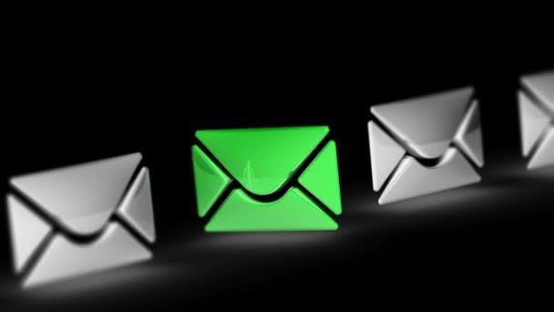 Ikonu e-mail v černém pozadí. Opakování záběru má rozlišení 4 k. ProRes 4444.