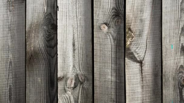 motion of aged wooden planks across screen
