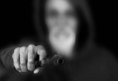 Very scary Image of a senior Latino with a Pistol pointed at the camera stock vector