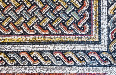 Colorful small tiles of an ancient floor mosaic, geometric ornament background