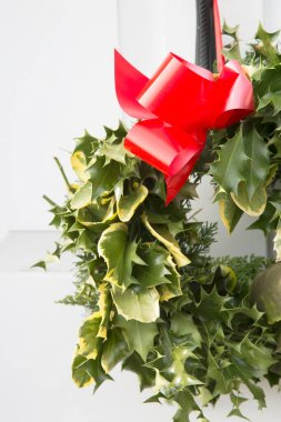 Christmas Wreath on White Door with Copy Space