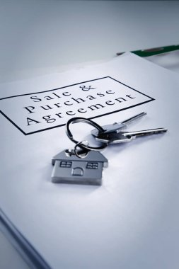 Mortgage loan agreement application with house shaped key-ring