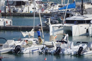 Italy, Sicily, Mediterranean sea, Marina di Ragusa (Ragusa Province); 21 September 2019, people, motor boats and luxury yachts in the port - EDITORIAL