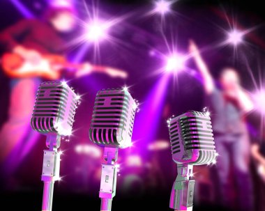 Music band on stage and vintage microphone.Live music and festival.Festive design background.Entertainment and leisure concept