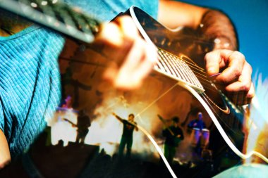 Playing guitar and concert concept.Live music background.Music festival.Instrument on stage and band.Stage lights.Abstract musical background