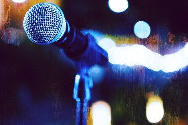 Live music background.Microphone and stage lights.Microphone and stage lights.Concert and music concept.