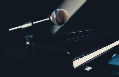 Close up image of microphone and grand piano.Jazz and relaxing music.Piano music background.3d illustration