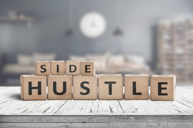 Side hustle sign on a plank table