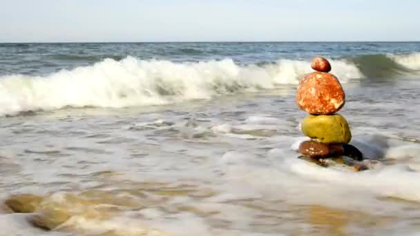 Zen stone pyramid at a beach surf
