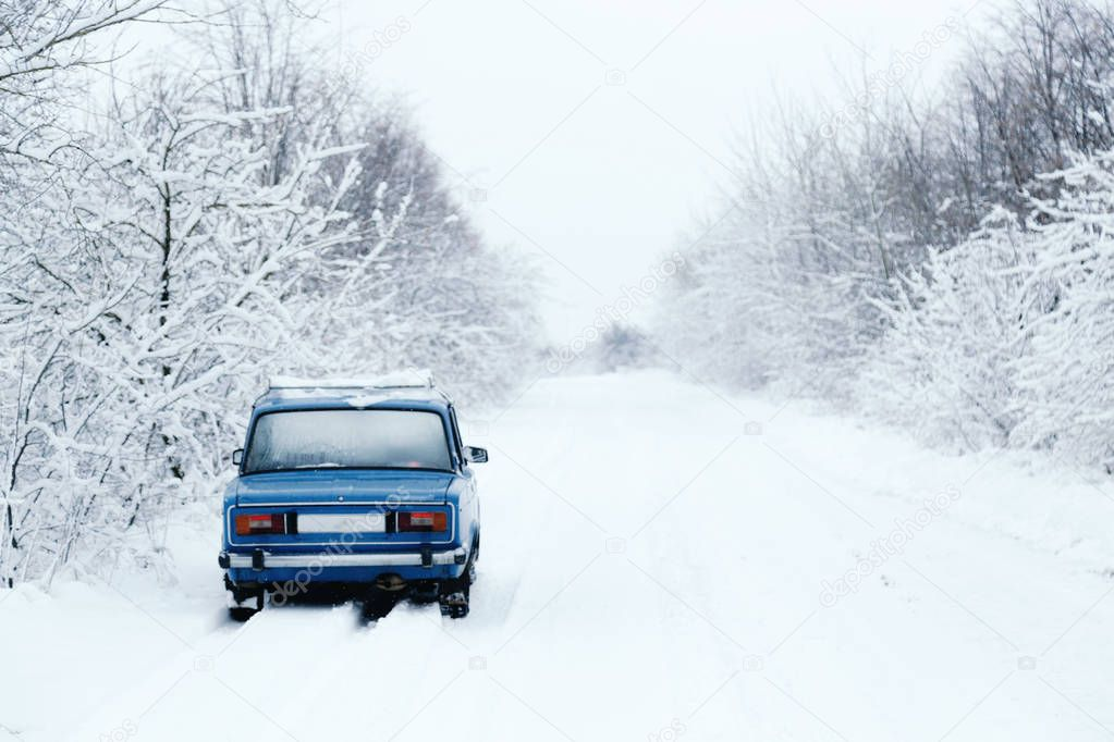 blue cars made in the USSR, in a snowy forest