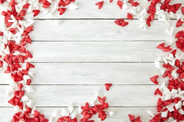White and red flying hearts bright love passion frame border white wooden background. confetti love signs holiday. for Valentines Day decoration, empty space for text