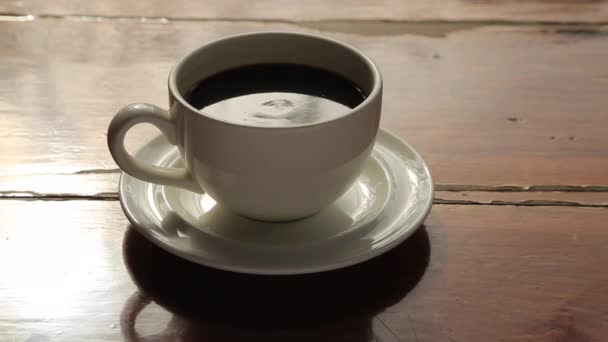 woman hand holding a cup Coffee on a wooden table. Morning coffee Space for text.