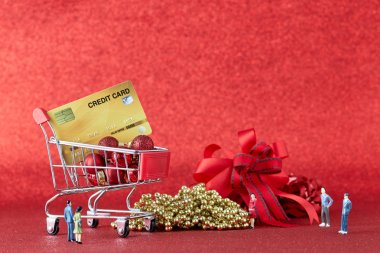 Shopping trolley with gift Christmas balls and credit card