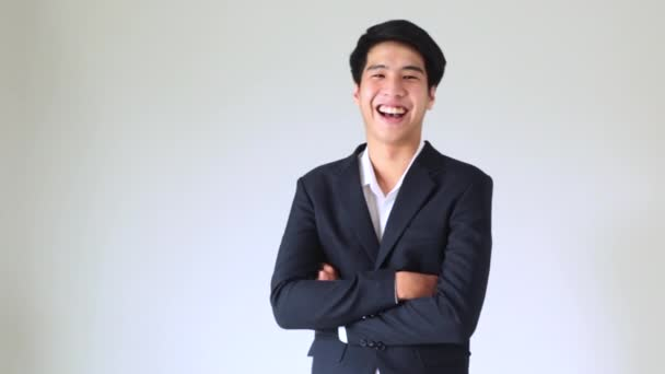 Happy young handsome smiling thai businessman In the office