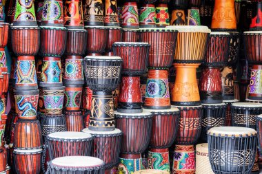 Fenghuang, China - September 22, 2017: Colorful wooden djembe drums at souvenir shop in Phoenix Ancient Town (Fenghuang). Fenghuang is a popular tourist destination of Asia.